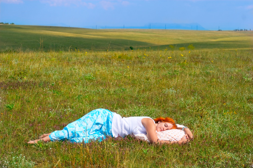 woman sleeping in field